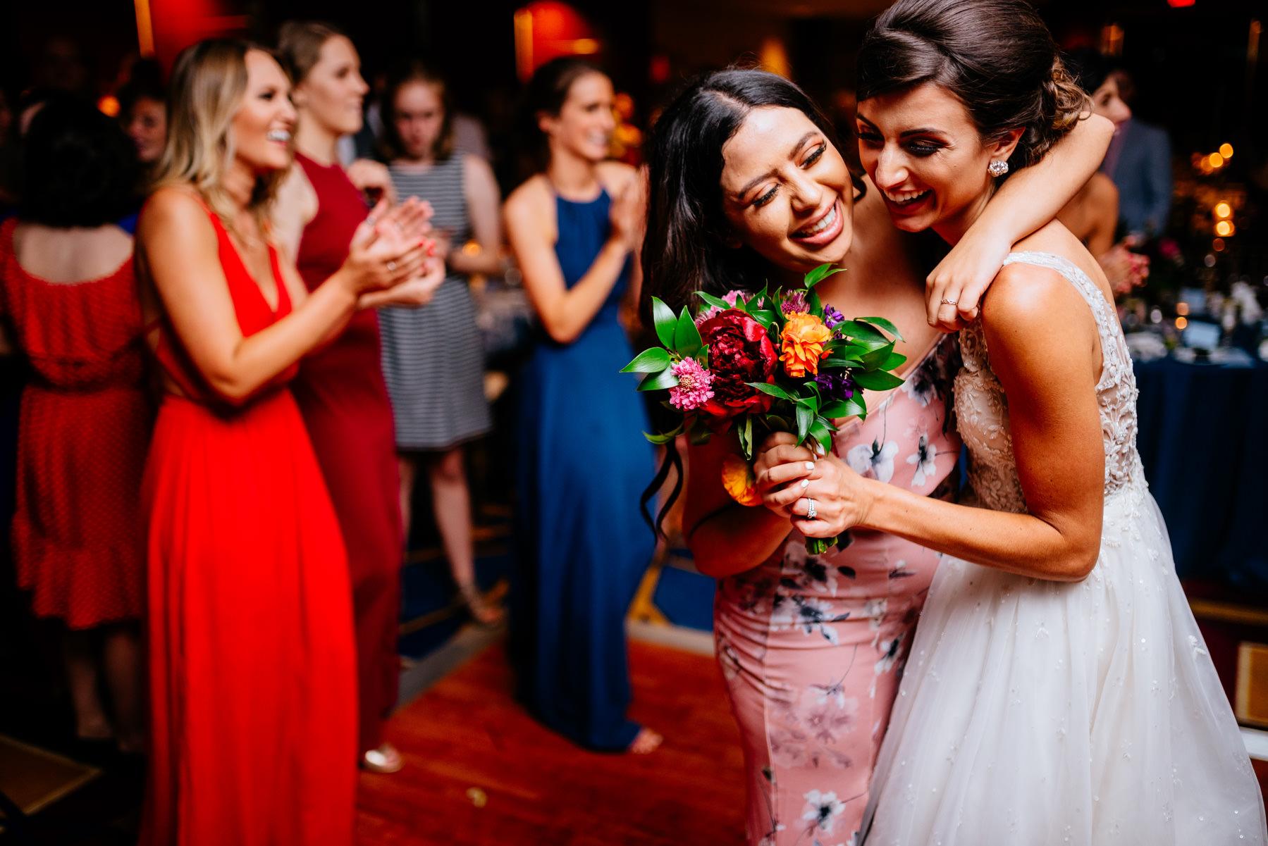 hugging bride during reception