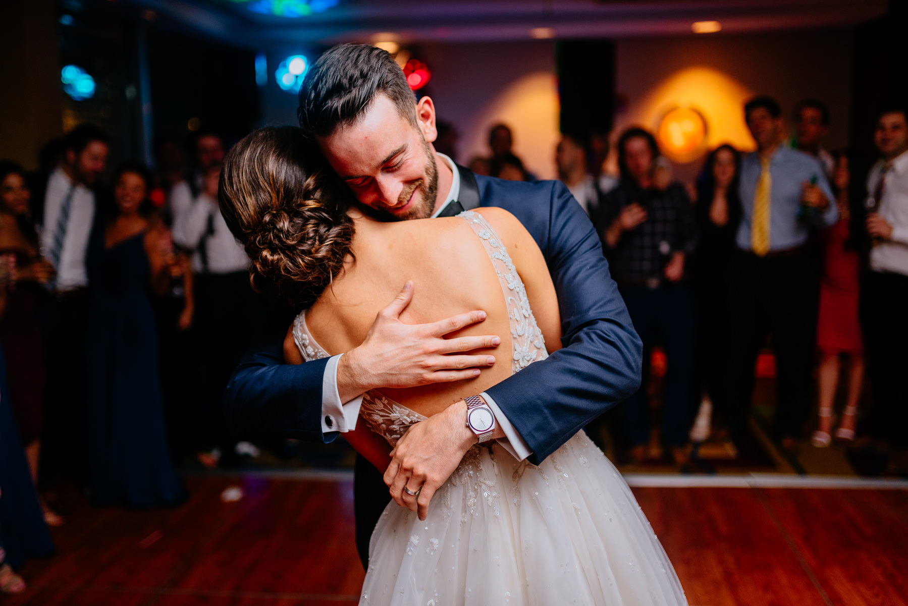 groom hugging bride during reception