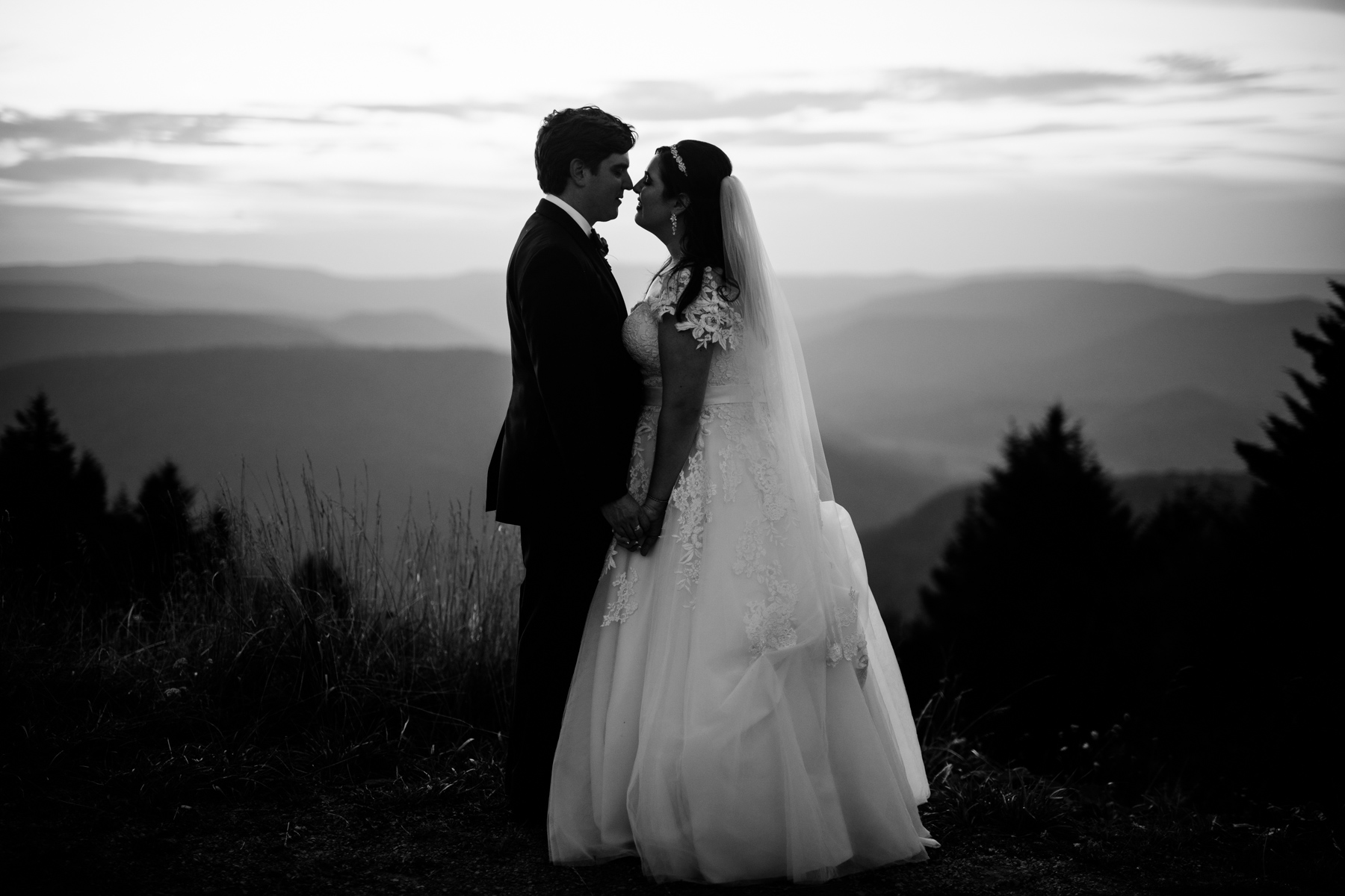 black and white bride and groom kissing allegheny mountains